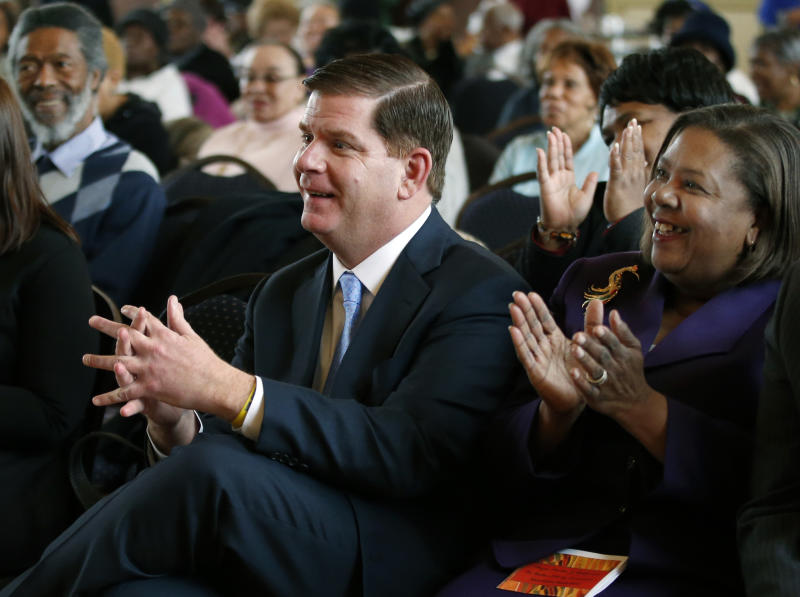 """Boston Mayor Martin Walsh applauds as he attends a Black History Month event in Boston, Thursday, Feb. 27, 2014. The mayors of New York City and Boston say they'll boycott St. Patrick's Day parades to protest policies on gay groups. Walsh said this week he's trying to broker a deal with his city's parade organizers to allow a group of gay military veterans to march. The son of Irish immigrants said that allowing gay groups to participate is """"long overdue."""" (AP Photo/Elise Amendola)"""