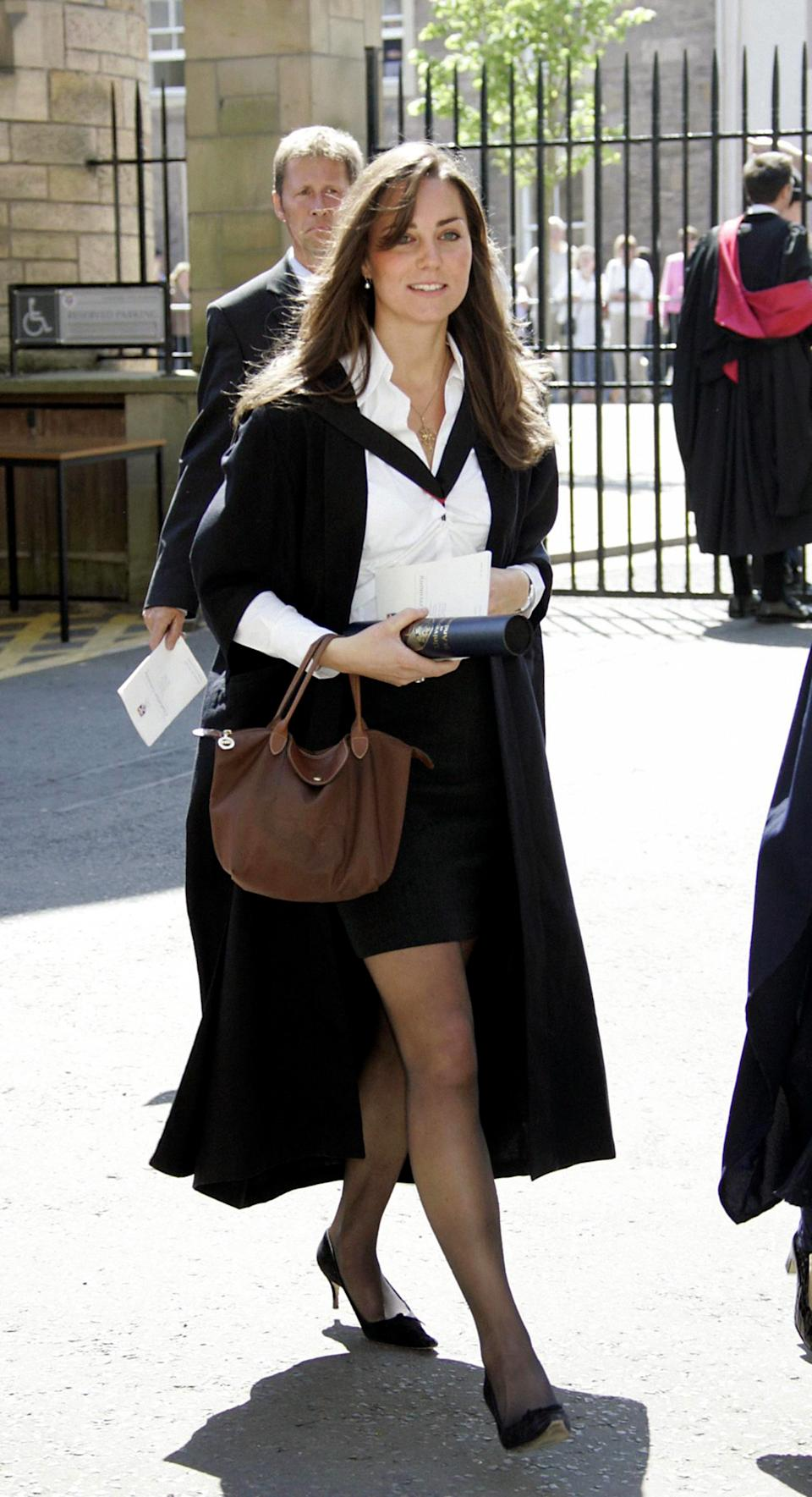 <p>Then-Kate Middleton, then-girlfriend of Prince William, during their graduation ceremony. Kate graduated in Art History and has pursued her love of photography through her royal work. (PA Images)</p>