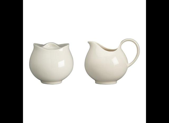 30b9685a60ad9 A sugar bowl and creamer designed by Zeisel in 1952