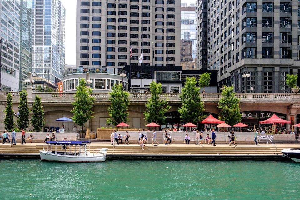 Chicago River with The River walk and surrounding downtown architecture in summer, Chicago, Illinois