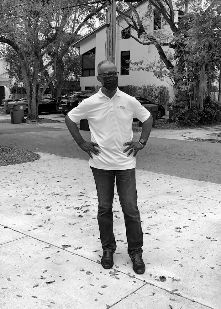 Michael Finney steps out for a moment of fresh air just outside of his residence in Miami.