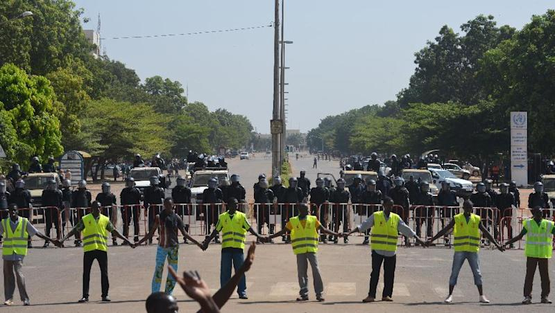 Police cordon off access to the parliament on October 29, 2014 in Ouagadougou as people demonstrate against the high cost of living in Burkina Faso (AFP Photo/Issouf Sanogo)