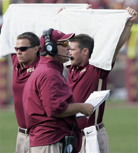 Florida State head coach Jimbo Fisher is shielded by towels as he calls a play against Duke in the first quarter of an NCAA college football game on Saturday, Oct. 27, 2012, in Tallahassee, Fla. Florida State won the game 48-7. (AP Photo/Steve Cannon)