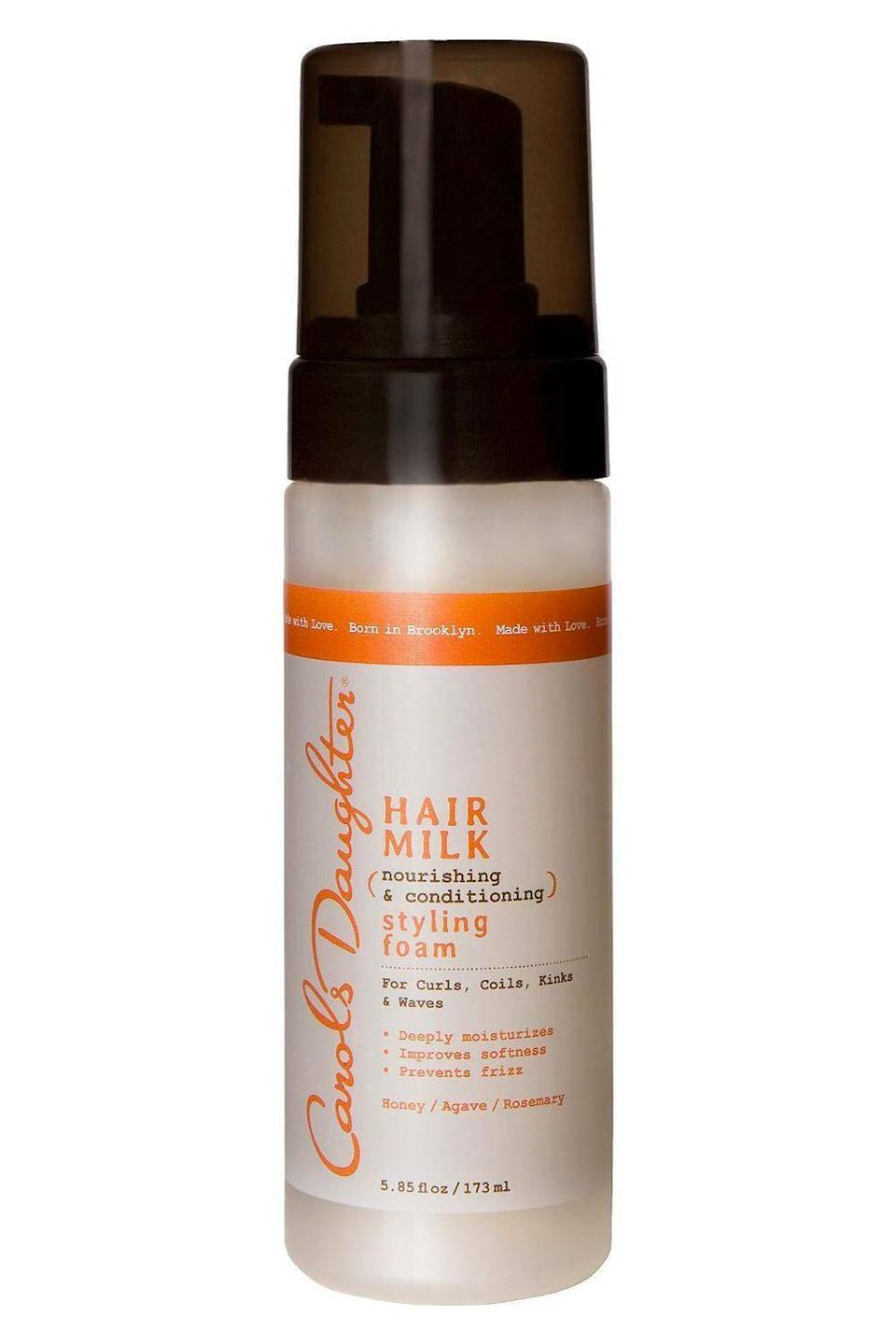 """<p><strong>Carol's Daughter</strong></p><p>target.com</p><p><strong>$13.49</strong></p><p><a href=""""https://www.target.com/p/carols-daughter-hair-milk-nourishing-and-conditioning-styling-foam-5-85-oz/-/A-15041866"""" rel=""""nofollow noopener"""" target=""""_blank"""" data-ylk=""""slk:Shop Now"""" class=""""link rapid-noclick-resp"""">Shop Now</a></p><p>If you have tighter curls, you know how it can be hard to find a mousse that won't make your hair stiff as hell. Enter: this <a href=""""https://www.cosmopolitan.com/style-beauty/beauty/g27345497/best-leave-in-conditioners-curly-hair/"""" rel=""""nofollow noopener"""" target=""""_blank"""" data-ylk=""""slk:conditioning"""" class=""""link rapid-noclick-resp"""">conditioning</a> foam. The formula <strong>contains honey extract, which gives it a flexible, non-sticky hold.</strong> Rub 2-3 pumps of mousse between your palms, then finger-comb it through your hair for defined curls that won't flake. </p>"""