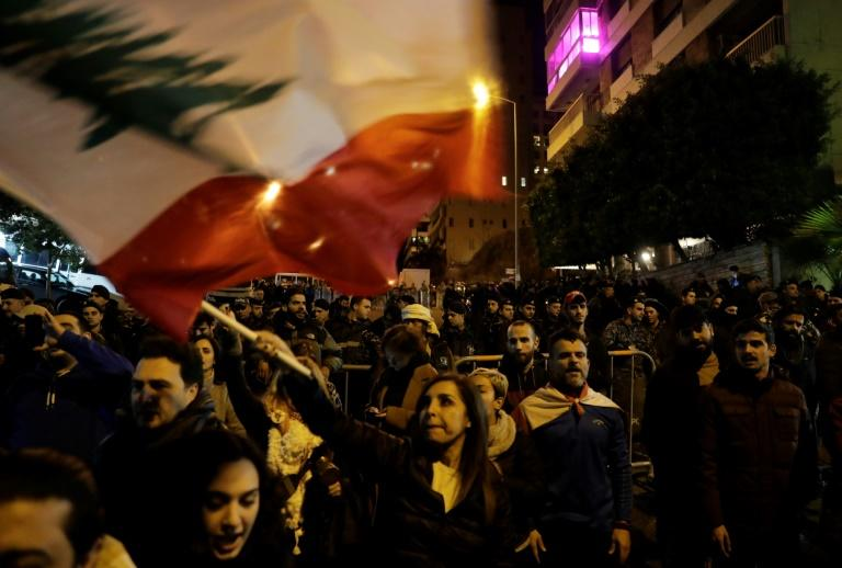 Dozens of Lebanese protesters gathered at the new prime minister's house in Beirut to call for his resignation