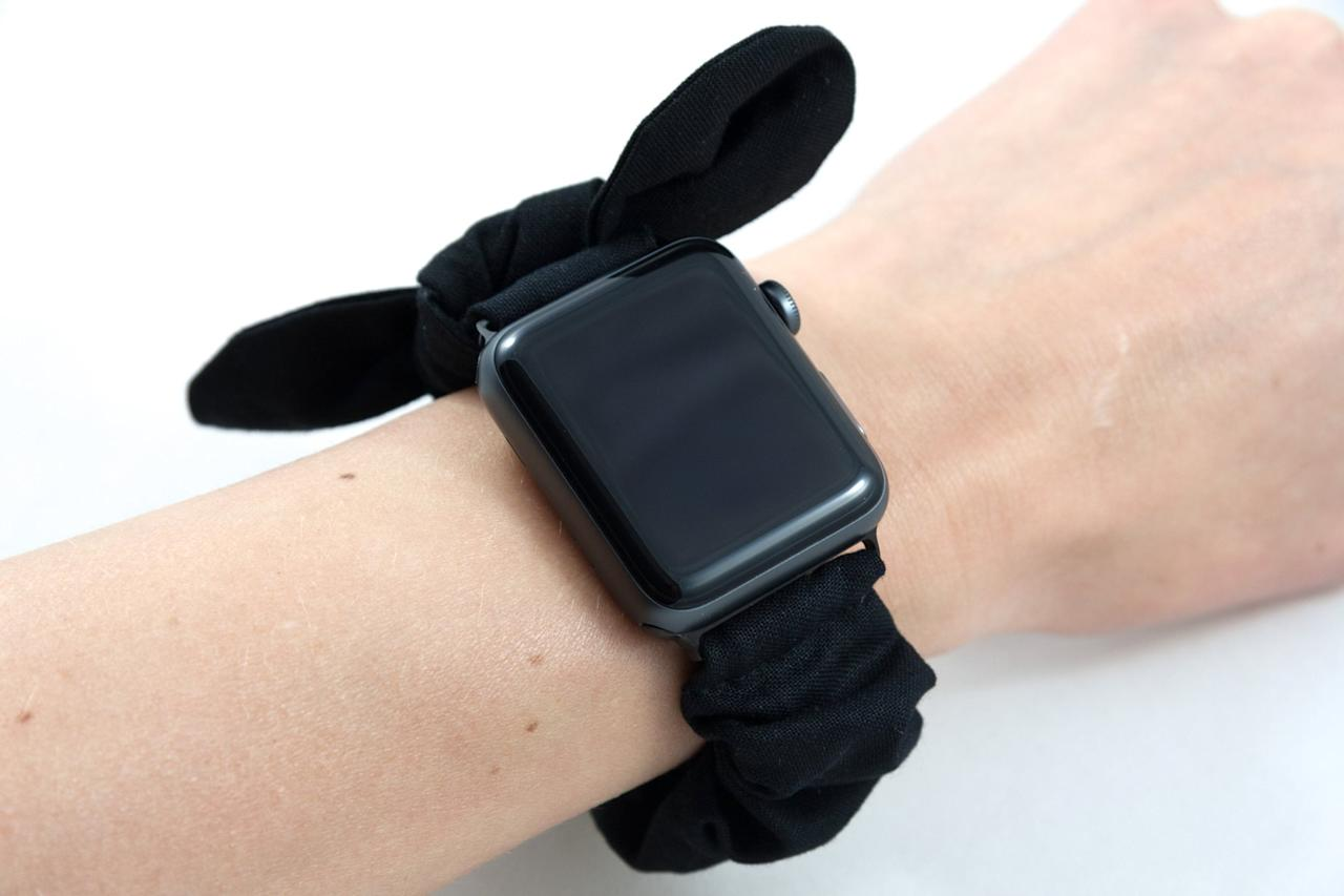 """<p>If your vibe is fun and sophisticated, you'll love this <a href=""""https://www.popsugar.com/buy/Black-Velvet-Bow-Scrunchie-Watch-Band-488472?p_name=Black%20Velvet%20Bow%20Scrunchie%20Watch%20Band&retailer=etsy.com&pid=488472&price=35&evar1=geek%3Aus&evar9=46586237&evar98=https%3A%2F%2Fwww.popsugar.com%2Fphoto-gallery%2F46586237%2Fimage%2F46586678%2FBlack-Velvet-Bow-Scrunchie-Watch-Band&list1=tech%2Cshopping%2Cwatches%2Capple%2Cscrunchies%2Cwearable%20tech&prop13=api&pdata=1"""" rel=""""nofollow"""" data-shoppable-link=""""1"""" target=""""_blank"""" class=""""ga-track"""" data-ga-category=""""Related"""" data-ga-label=""""https://www.etsy.com/listing/733424325/black-apple-watch-scrunchie-band-with"""" data-ga-action=""""In-Line Links"""">Black Velvet Bow Scrunchie Watch Band</a> ($35).</p>"""