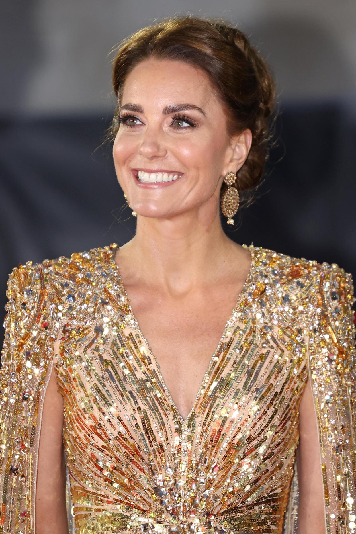 The mum-of-three finished off the look with matching embellished gold earrings and a chic updo. (Getty Images)