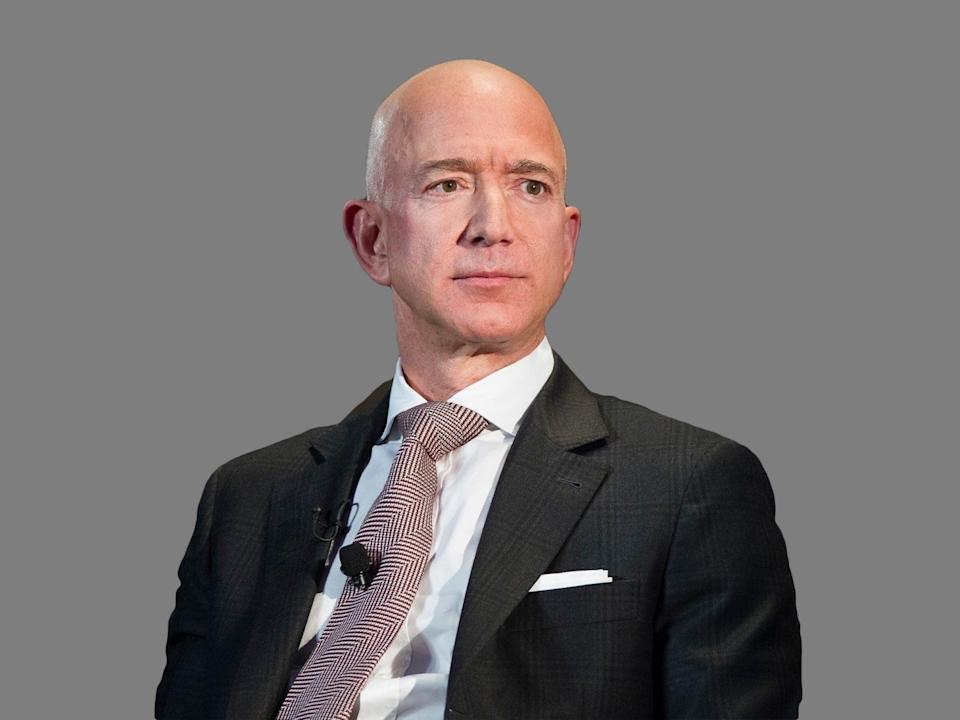 Jeff Bezos headshot, as  Amazon founder and CEO, watches on stage during a news conference unveiling the new Blue Origin rocket at the Cape Canaveral Air Force Station in Cape Canaveral, graphic element on gray