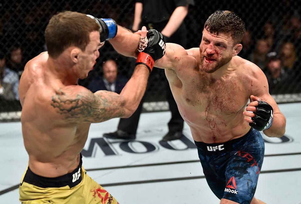 BROOKLYN, NEW YORK - APRIL 07:  (R-L) Calvin Kattar punches Renato Moicano of Brazil in their featherweight bout during the UFC 223 event inside Barclays Center on April 7, 2018 in Brooklyn, New York. (Photo by Jeff Bottari/Zuffa LLC/Zuffa LLC via Getty Images)
