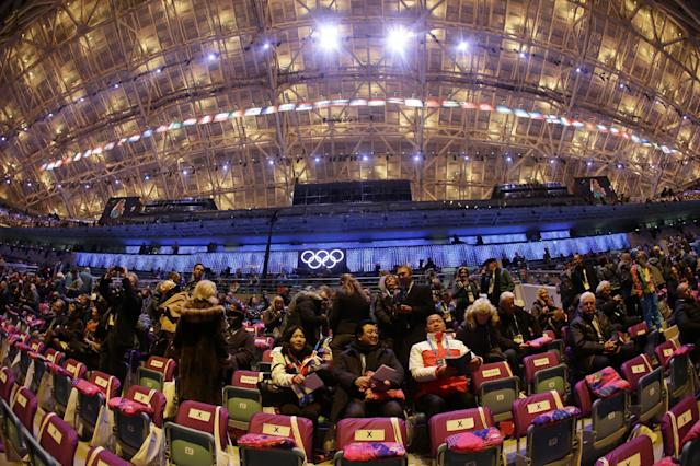 In a photo taken with a fisheye lens, spectators arrive at the Fisht Olympic Stadium prior to the start of the opening ceremony of the 2014 Winter Olympics in Sochi, Russia, Friday, Feb. 7, 2014. (AP Photo/Mark Humphrey)