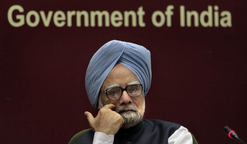 In this Tuesday, Nov. 23, 2010 file photo, Indian Prime Minister Manmohan Singh listens to a speaker during a conference in New Delhi, India.  Manmohan Singh's coalition has splintered and his government is fighting for survival. But the Indian prime minister, who has been criticized for presiding meekly over a corrupt government, is suddenly being hailed as a bold, powerful leader. Since pushing through a battery of unexpected economic reforms in mid- Sept. 2012, and refusing to back down in the face of protests and political threats, Singh appeared to have rejuvenated a government thought hopelessly paralyzed.  (AP Photo/Manish Swarup, File)