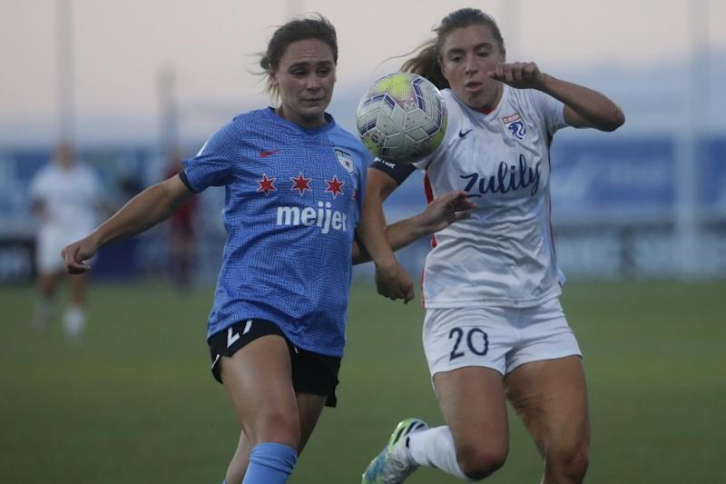 Chicago Red Stars' Bianca St Georges, left, and Reign's Sofia Huerta (20) battle for the ball at Zions Bank Stadium