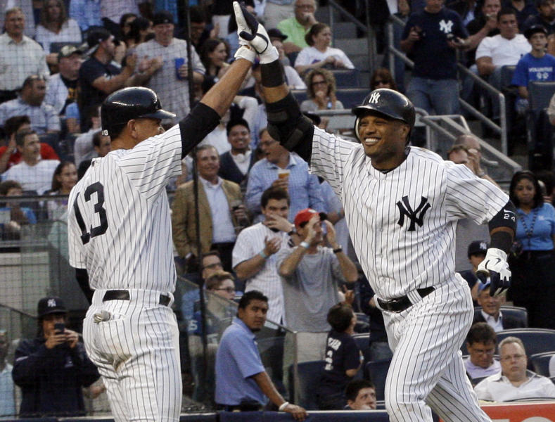 New York Yankees' Robinson Cano, right, celebrates with Alex Rodriguez (13) after hitting a two-run home run during the third inning of an interleague baseball game against the New York Mets on Friday, June 8, 2012, in New York. (AP Photo/Frank Franklin II)