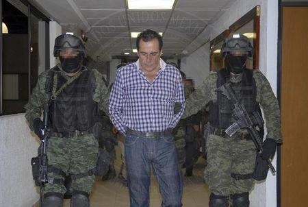Handout picture of soldiers escorting the head of the Beltran Leyva drug cartel, Hector Beltran Leyva in Mexico City