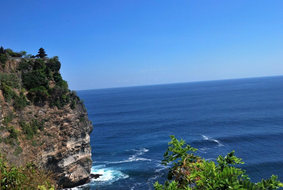 <b>Pura Uluwatu is one of Bali's most spectacular temples</b><br><br>Bali's shrines are often located in the most exotic landscapes. This is Pura Uluwatu right atop the cliff. The scenery is breathtaking as you climb uphill through a small forested area patrolled by boisterous monkeys.