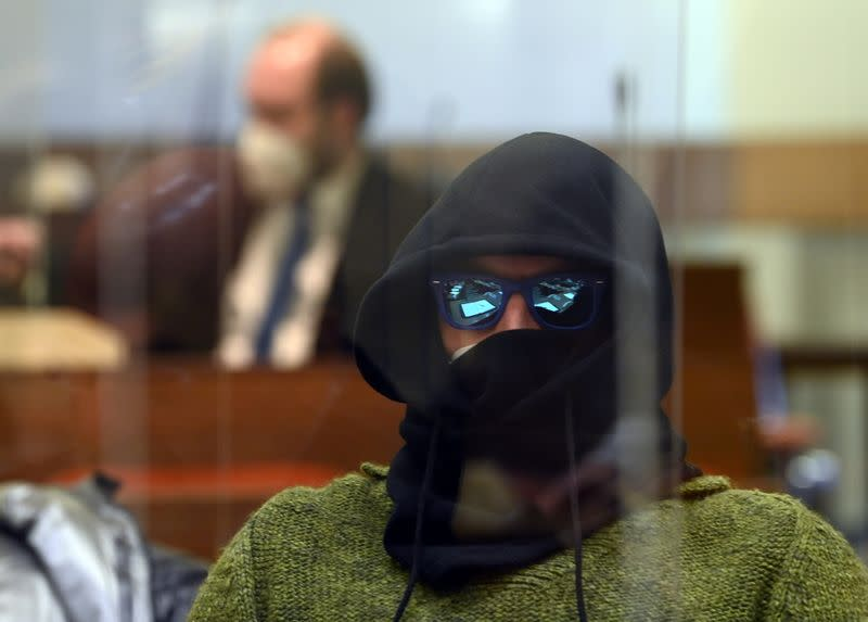 A co-defendant waits for the verdict in the trial of German sports doctor Mark S. (not pictured), accused of masterminding an international doping network in cycling and winter sports, at the Regional Court (Landgericht) in Munich