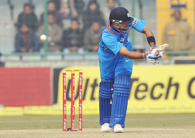 Virat Kohli (India) in an action against Pakistan during the 3rd One Day Internationals Match between India & Pakistan at Ferozeshah Kotla Stadium in Delhi on January 6, 2013. P D Photo by Asish Maitra