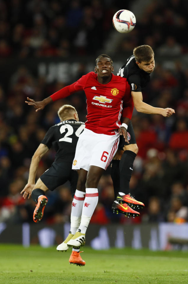 Britain Soccer Football - Manchester United v FC Zorya Luhansk - UEFA Europa League Group Stage - Group A - Old Trafford, Manchester, England - 29/9/16 Manchester United's Paul Pogba in action with FC Zorya Luhansk's Eduard Sobol and Dmytro Grechyshkin  Action Images via Reuters / Jason Cairnduff Livepic EDITORIAL USE ONLY.