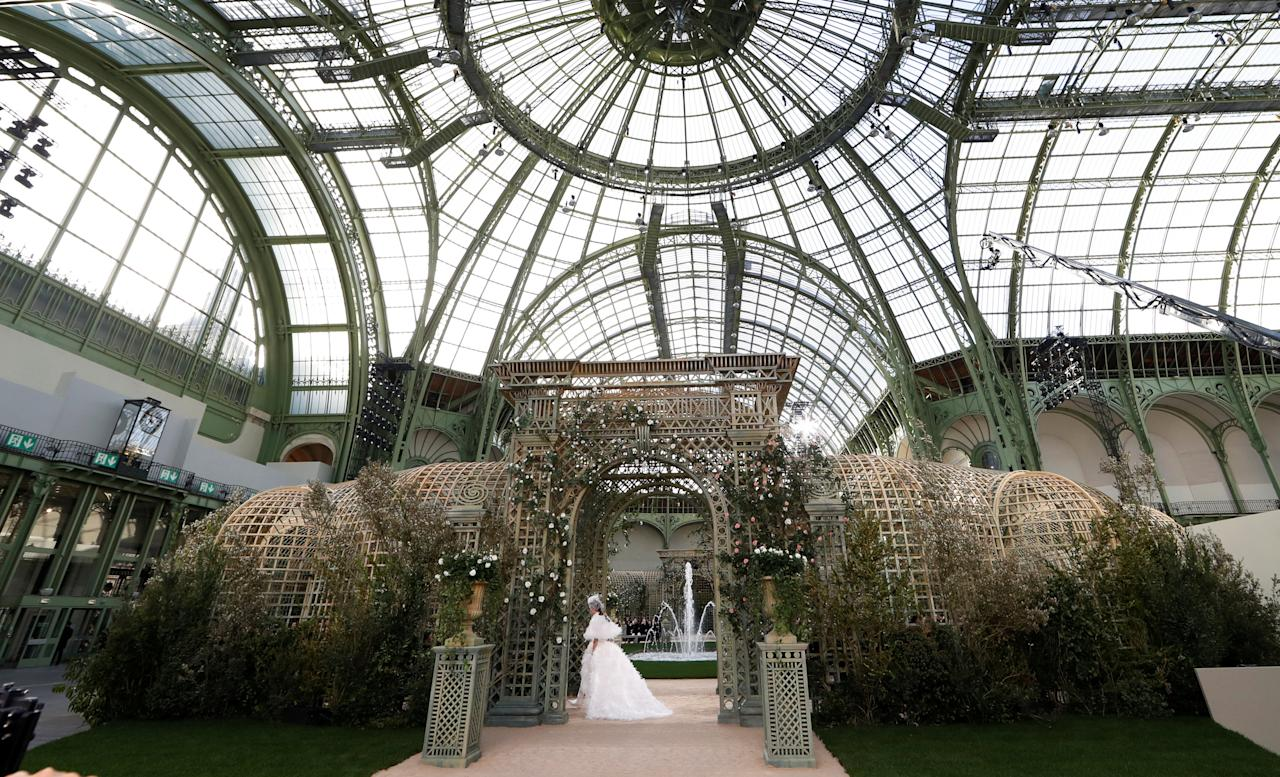 A general view shows the Grand Palais as a model presents a creation by German designer Karl Lagerfeld as part of his Haute Couture Spring-Summer 2018 fashion collection for fashion house Chanel in Paris, France January 23, 2018. REUTERS/Gonzalo Fuentes