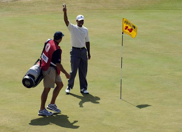 "<h1 class=""title"">Golf - The 135th Open Championship 2006 - Day Two - Royal Liverpool - Hoylake</h1> <div class=""caption""> USA's Tiger Woods retrieves his ball from the 14th hole after making eagle during the second round of the 135th Open Championship at Royal Liverpool Golf Club, Hoylake. (Photo by Rebecca Naden - PA Images/PA Images via Getty Images) </div> <cite class=""credit"">Rebecca Naden - PA Images</cite>"