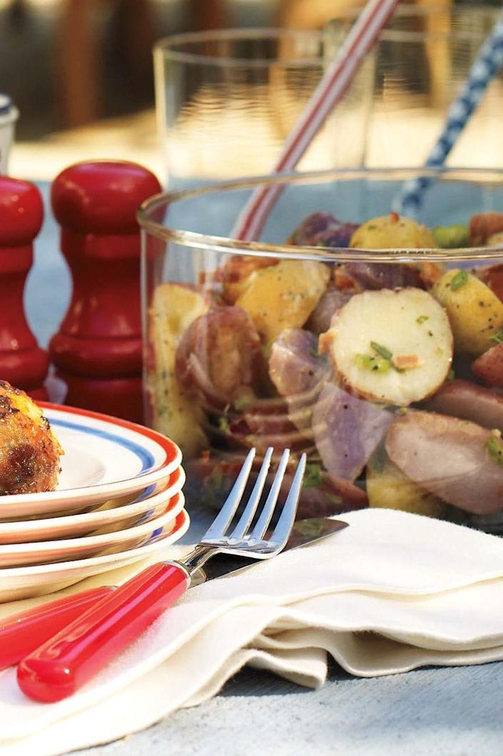 """<p>Featuring tarragon-tinged red, white, and blue baby potatoes tossed in hot bacon dressing, this potato salad is certainly worth celebrating.</p><p><strong><em><u><u><a href=""""https://www.womansday.com/food-recipes/food-drinks/recipes/a11447/red-white-blue-potato-salad-recipe-122673/"""" rel=""""nofollow noopener"""" target=""""_blank"""" data-ylk=""""slk:Get the recipe for Red, White, and Blue Potato Salad"""" class=""""link rapid-noclick-resp"""">Get the recipe for Red, White, and Blue Potato Salad</a>.</u></u></em> </strong></p>"""