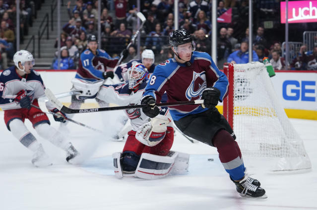 Colorado Avalanche defenseman Cale Makar (8) skates past the goal after scoring his second goal of the game against Columbus Blue Jackets goaltender Joonas Korpisalo (70) during the second period of an NHL hockey game, Saturday, Nov. 9, 2019, in Denver. (AP Photo/Jack Dempsey)