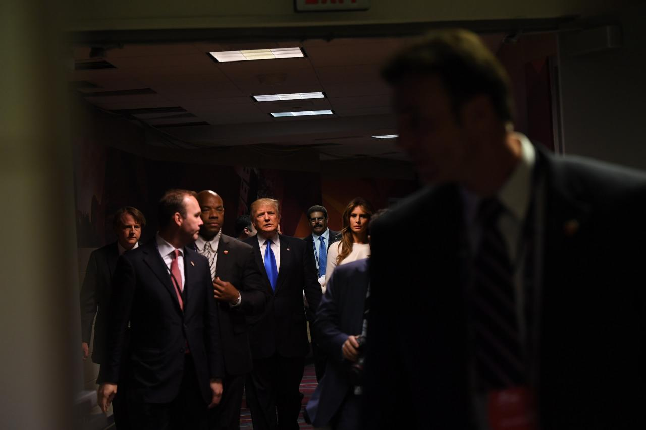 <p>Republican presumptive nominee for President of The United States, and his wife Melania Trump make their way through Quicken Loans Arena during the opening day of the Republican National Convention on July 18, 2016. (Photo: Toni L. Sandys/The Washington Post via Getty Images)</p>