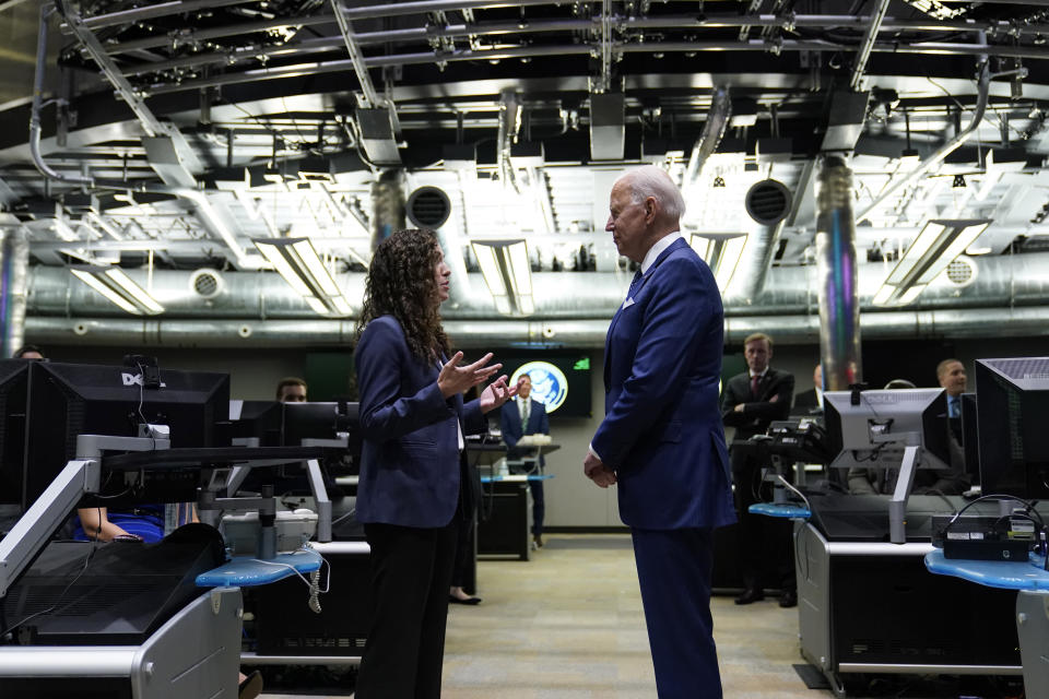 President Joe Biden talks with National Counterterrorism Center Director Christy Abizaid during a visit to the Office of the Director of National Intelligence in McLean, Va., Tuesday, July 27, 2021. This is Biden's first visit to an agency of the U.S. intelligence community. (AP Photo/Susan Walsh)