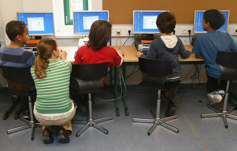 BERLIN - SEPTEMBER 18: Fourth-grade students learn computer skills in the elementary school at the John F. Kennedy Schule dual-language public school on September 18, 2008 in Berlin, Germany. The German government will host a summit on education in Germany scheduled for mid-October in Dresden. Germany has consistantly fallen behind in recent years in comparison to other European countries in the Pisa education surveys, and Education Minister Annette Schavan is pushing for an 8 percent increase in the national educaiton budget for 2009. (Photo by Sean Gallup/Getty Images)