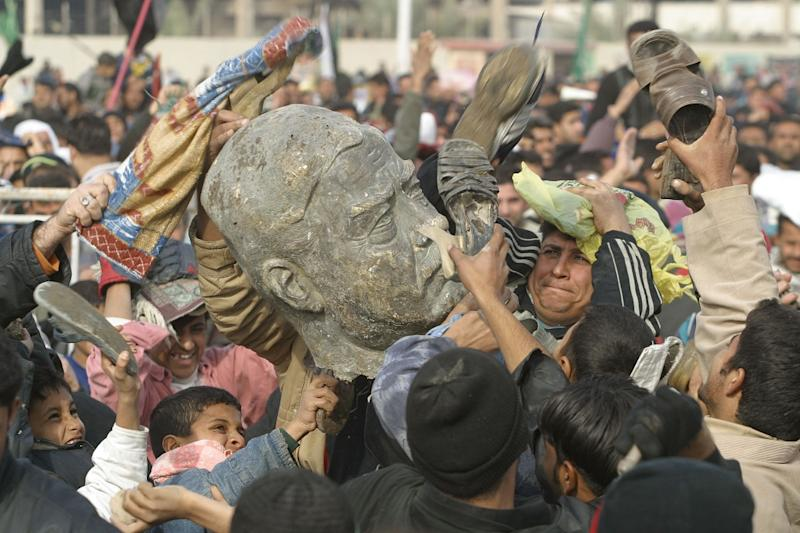 Iraqi Shiites beat a bust of ousted president Saddam Hussein during a 2003 rally in Sadr City (AFP Photo/Ahmad al-Rubaye)