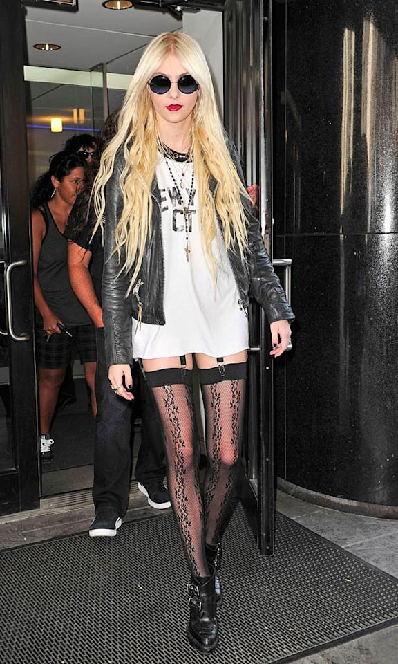 """Gossip Girl"" star Taylor Momsen appeared reckless and unpretty in a faded tee and fishnets while visiting the ""Good Day New York"" studios with her band, The Pretty Reckless. <a href=""http://www.pacificcoastnews.com/"" target=""new"">PacificCoastNews.com</a> - June 22, 2010"