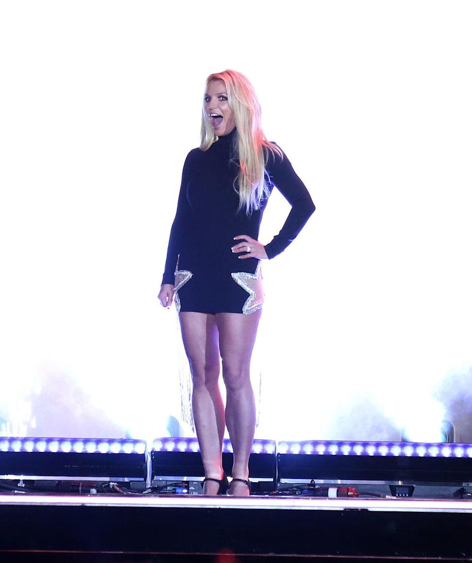 """<p>The icon wears a black high-neck mini with star-shaped cutouts on each side to announce her new residency, """"Britney: Domination,"""" at Park MGM in Vegas. </p>"""