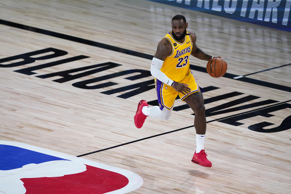 LAKE BUENA VISTA, FLORIDA - AUGUST 01: LeBron James #23 of the Los Angeles Lakers controls the ball during the first half of an NBA basketball game against the Toronto Raptors at The Arena in the ESPN Wide World Of Sports Complex on August 1, 2020 in Lake Buena Vista, Florida. NOTE TO USER: User expressly acknowledges and agrees that, by downloading and or using this photograph, User is consenting to the terms and conditions of the Getty Images License Agreement. (Photo by Ashley Landis - Pool/Getty Images)