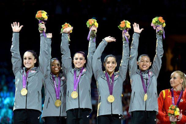 PHOTO: U.S. gold medalists Jordyn Wieber, Gabrielle Douglas, Mckayla Maroney, Alexandra Raisman and Kyla Ross celebrate on the podium of the women's team artistic gymnastics event of the London Olympic Games on July 31, 2012 in London.  (AFP via Getty Images, FILE)