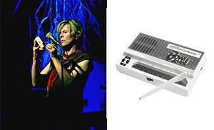 """IMAGE DISTRIBUTED FOR DUBREQ LTD – In this image released on Friday, Sept. 17, 2021, British musician David Bowie plays the Stylophone during the 'A Reality Tour' at The Shrine Auditorium in Los Angeles, February 2004. It was the last concert tour of his career. David Bowie's career-long association with the world's first 'pocket synthesizer' is being celebrated with the launch of a Bowie Stylophone. The iconic instrument famously featured on his breakthrough 1969 single """"Space Oddity"""". Press release and media available to download at http://www.apmultimedianewsroom.com/multimedia-newsroom/stylophone. HANDOUT IMAGE – Please see special instructions. (Mark Adams/Dubreq Ltd via AP Images)"""