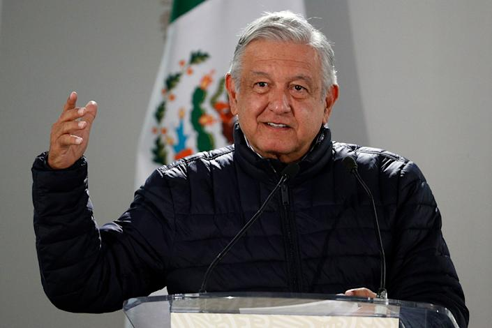 Mexican President Andres Manuel Lopez Obrador speaks after visiting facilities at a Mexican Social Security Institute (IMSS) hospital that will be converted to receive patients suffering from Covid-19, in the Coyoacan district of Mexico City, Friday, April 3, 2020. Lopez Obrador said Thursday that sections of 80 public hospitals were being isolated and prepared with an average of eight beds and respirators to care for an expected influx of patients with the new coronavirus. (AP Photo/Rebecca Blackwell)