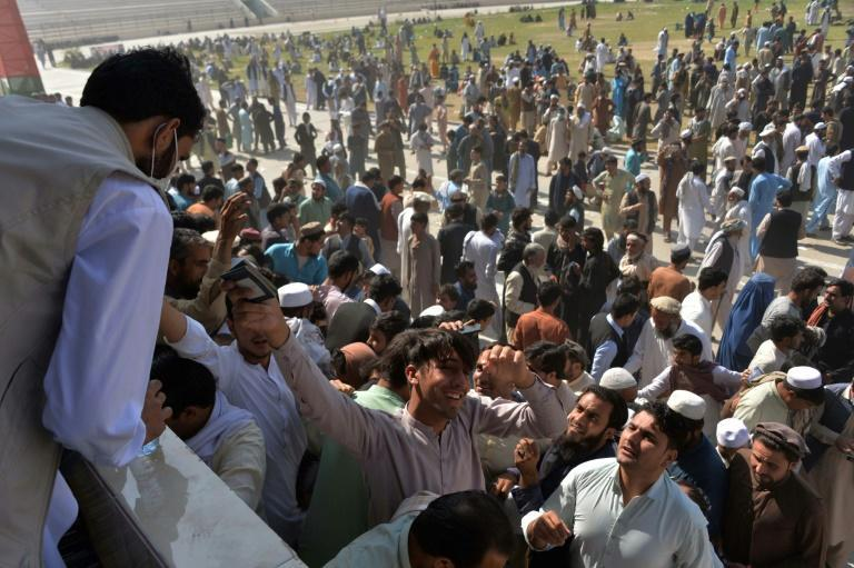 Large crowds gathered in a bid to secure permission to travel to Pakistan