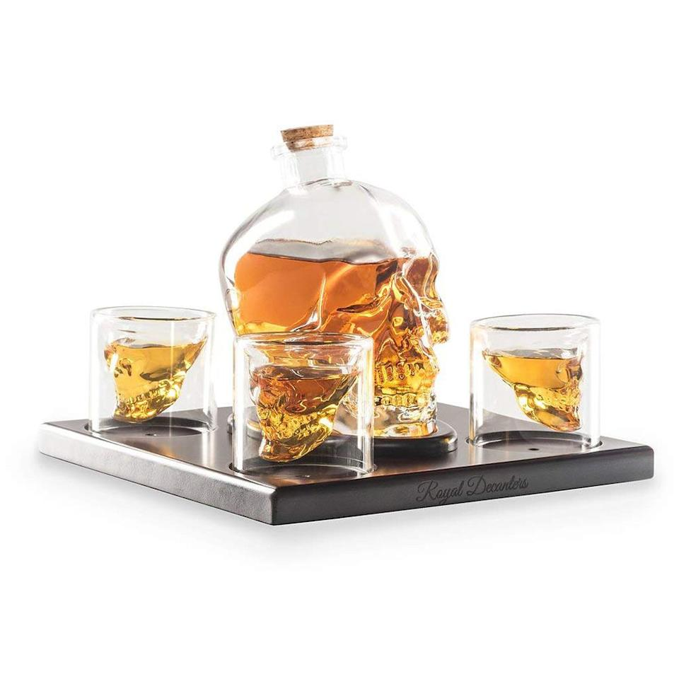 """<p><strong>Royal Decanters</strong></p><p>amazon.com</p><p><strong>$74.95</strong></p><p><a rel=""""nofollow"""" href=""""http://www.amazon.com/dp/B072K9F286/"""">Shop Now</a></p><p><strong>For His Home Bar</strong></p><p>He'll be so stoked for this gift, he'll be dead! This artisan-crafted large crystal skull decanter can hold a standard bottle of liquor with a 750-milliliter capacity and comes with four bar glasses that add some badass style to his mancave. It's masculine elegance at its finest. </p>"""
