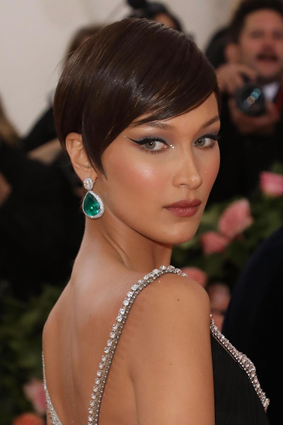 While Hadid's Met Gala cut was just a wig, her swooping bangs are still a great reference to bring to your hairdresser.