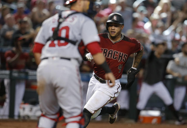 Arizona Diamondbacks' Ketel Marte (4) scores a run against the Washington Nationals on a ball hit by Adam Jones in the seventh inning during a baseball game, Sunday, Aug. 4, 2019, in Phoenix. (AP Photo/Rick Scuteri)