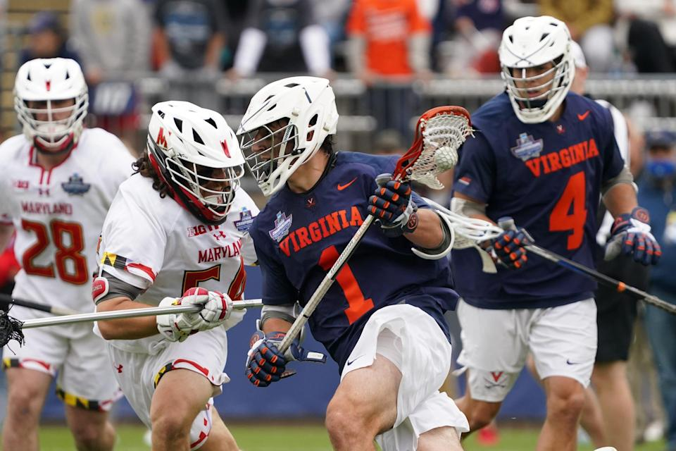 Virginia's Connor Shellenberger (1) moves the ball against Maryland defender Nick Grill (54) during the second half of the 2021 NCAA Div. I men's lacrosse championship.