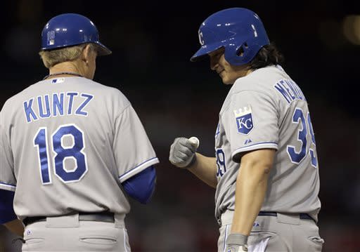 Kansas City Royals' Luis Mendoza, right, is congratulated by first base coach Rusty Kuntz after hitting an RBI single during the fifth inning of a baseball game Wednesday, May 29, 2013, in St. Louis. (AP Photo/Jeff Roberson)