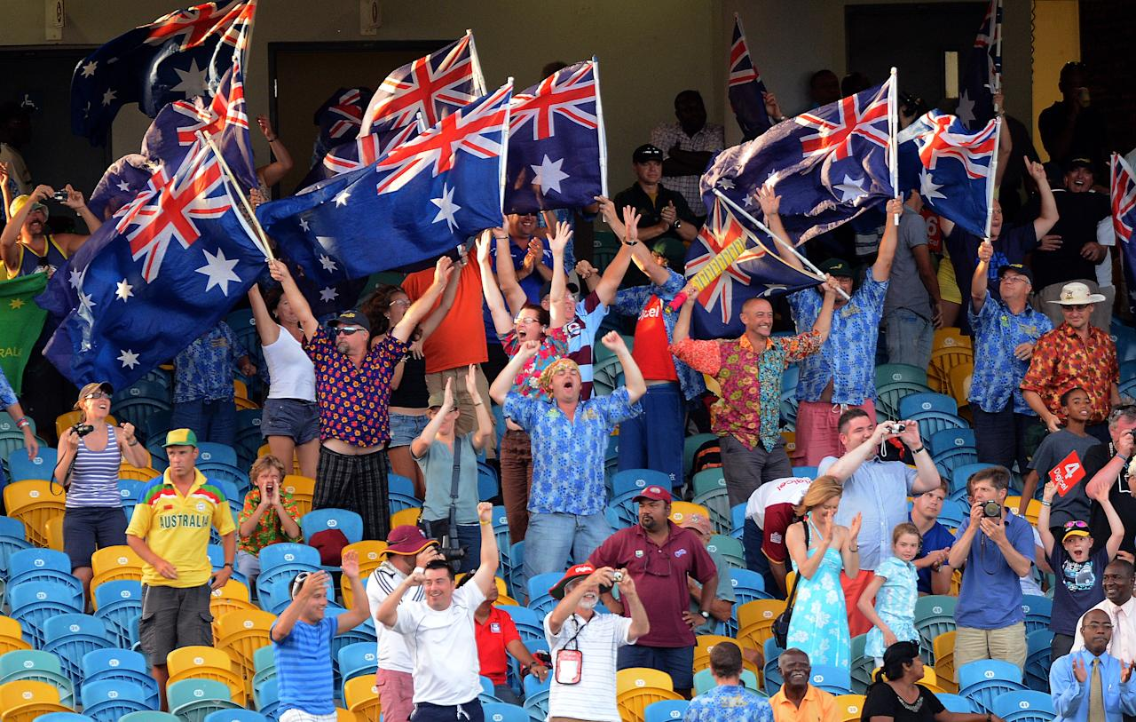 Australian cricket fans cheer their team's victory during the final day of the first-of-three Test matches between Australia and West Indies at the Kensington Oval stadium in Bridgetown on April 11, 2012. Australia defeated West Indies by 3 wickets. AFP PHOTO/Jewel Samad (Photo credit should read JEWEL SAMAD/AFP/Getty Images)