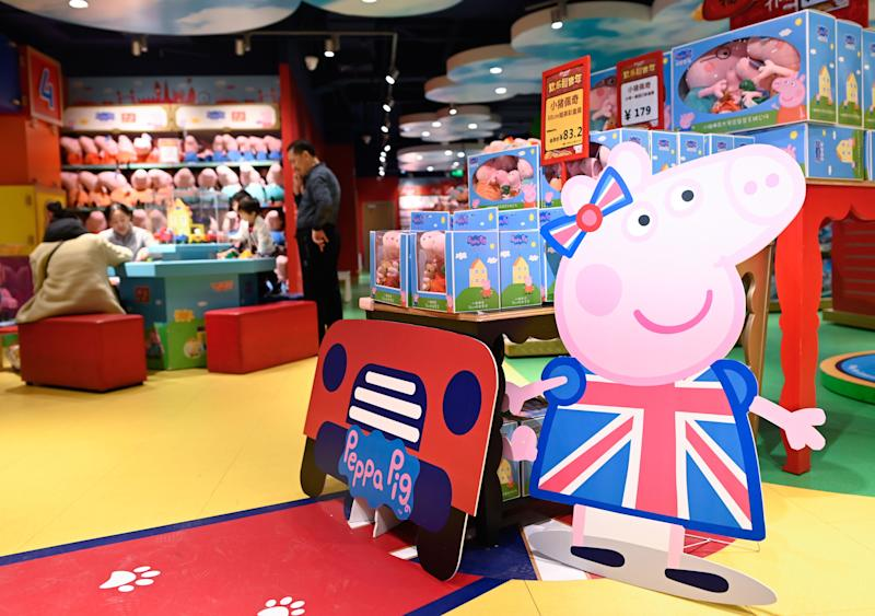 "(FILES) In this file photo taken on January 25, 2019, a billboard of Peppa Pig is displayed at a toy store in Beijing. - US toymaker Hasbro announced on August 22, 2019, that it is acquiring studio Entertainment One, which owns popular cartoon series ""Peppa Pig"" among other children's content, for approximately $4 billion. Under the all-cash transaction, Entertainment One shareholders will receive £5.60 ($6.86) per share, according to a statement from Hasbro. In addition to Peppa Pig, the pink swine with a British accent who loves jumping in muddy puddles, the purchase includes the successful children's cartoon ""PJ Masks,"" about a trio of young friends who become superheroes at night. (Photo by WANG Zhao / AFP) (Photo credit should read WANG ZHAO/AFP/Getty Images)"