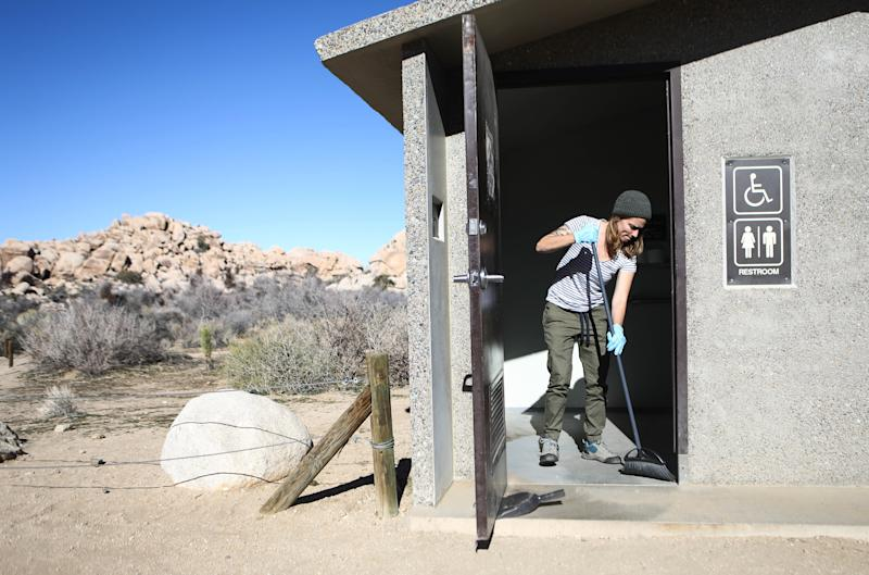Volunteer Alexandra Degen cleans a restroom at Joshua Tree National Park on Jan. 4, 2019 in Joshua Tree National Park, California. Volunteers with 'Friends of Joshua Tree National Park' have been cleaning bathrooms and trash at the park as the park is drastically understaffed during the partial government shutdown. Campgrounds and some roads have been closed at the park due to safety concerns.