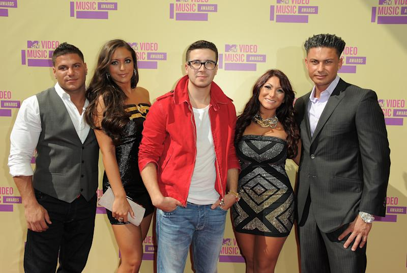 """Cast members from MTV's """"Jersey Shore,"""" from left, Ronnie Ortiz-Magro, Samantha Giancola, Vinny Guadagnino, Deena Nicole Cortese and Paul DelVecchio arrive at the MTV Video Music Awards on Thursday, Sept. 6, 2012, in Los Angeles. (Photo by Jordan Strauss/Invision/AP)"""