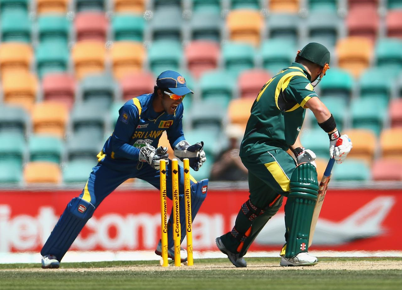 HOBART, AUSTRALIA - JANUARY 23:  David Warner of Australia is bowled by Tillakaratne Dilshan of Sri Lanka during game five of the Commonwealth Bank One Day International Series between Australia and Sri Lanka at Blundstone Arena on January 23, 2013 in Hobart, Australia.  (Photo by Robert Cianflone/Getty Images)