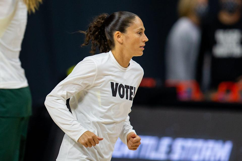 """Sue Bird has taken an active role in social and political causes in recent years Here she wears a """"Vote!"""" shirt before Game 2 of the 2020 WNBA semifinals."""