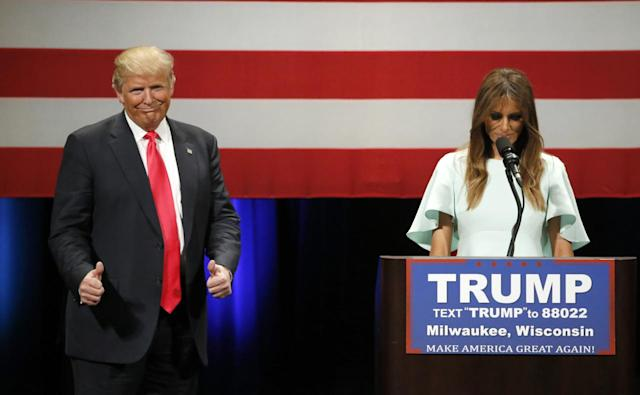 <p>Trump reacts to the words of his wife Melania as she addresses the crowd at a rally at the Milwaukee Theatre, April 4, 2016, in Milwaukee.<i> (Photo: Charles Rex Arbogast/AP)</i> </p>