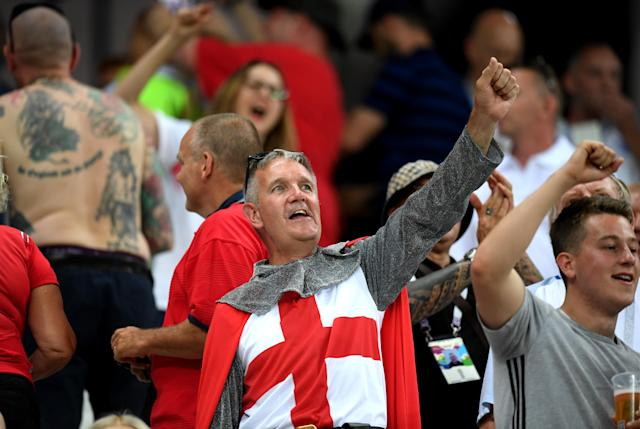 <p>Happy and glorious: An England fan in chainmail fancy dress before the Three Lions' clash with Tunisia. (Getty) </p>